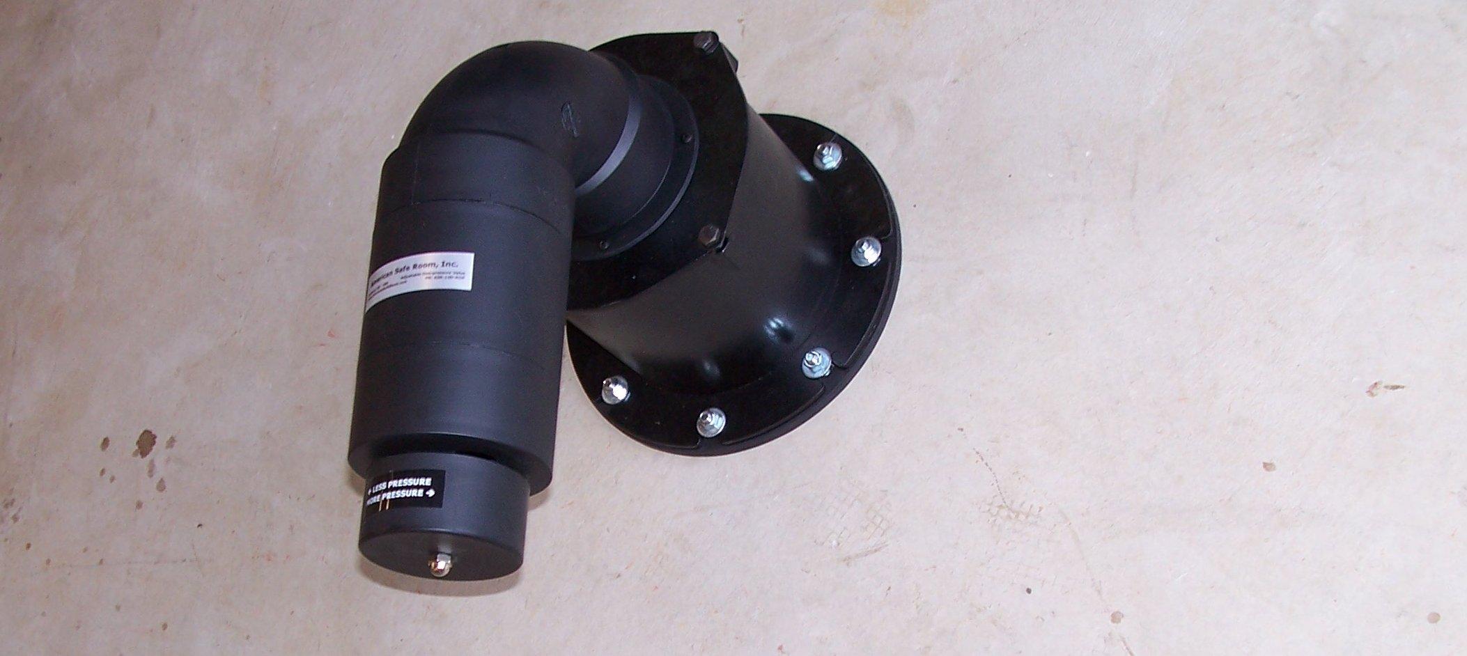 Wall mounted adjustable overpressure valve