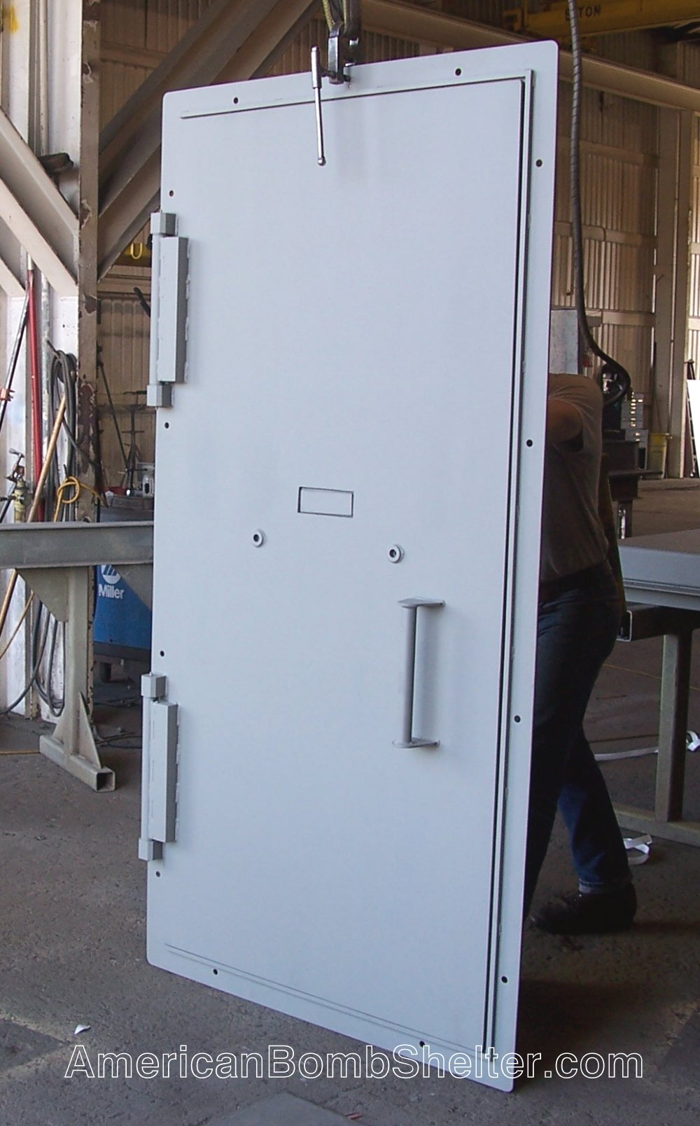 Steel ballistic door for a safe room