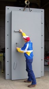 Blast doors for a hydroelectric plant