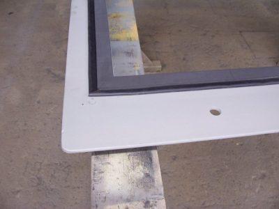 Compression seal on a blast door