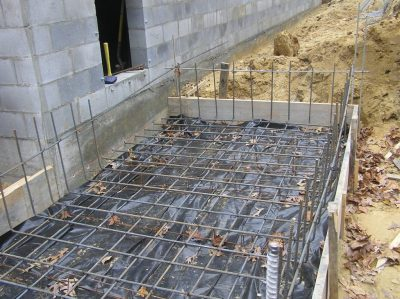 The rebar is tied into the shelter floor slab