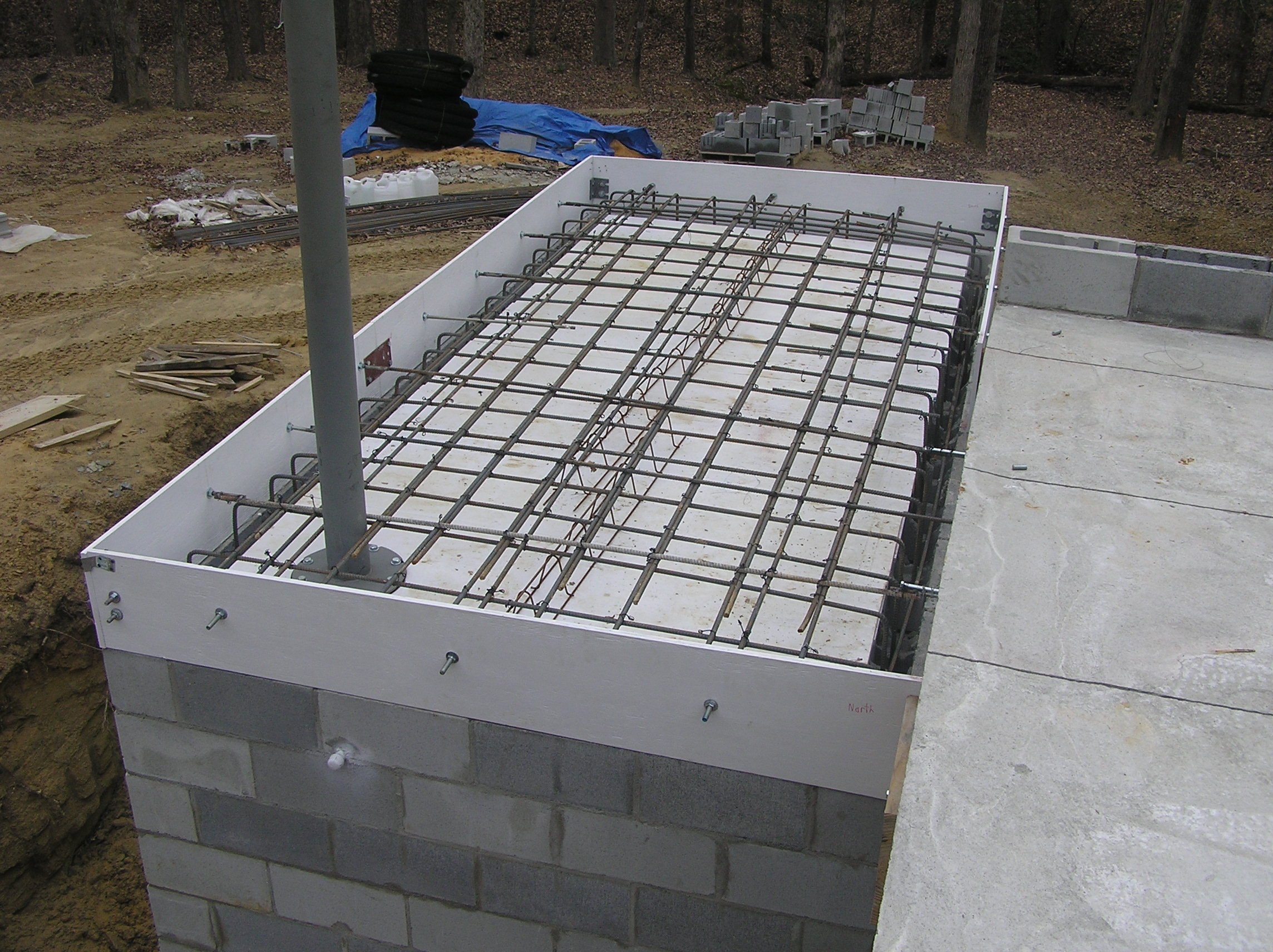 Shelter build series 1 american safe room 39 s underground shelter kit - How put cement foundations ceilings ...