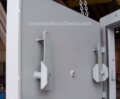 Rotating cam latches