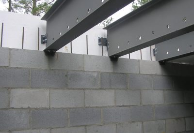 The truss centering brackets and form board connection