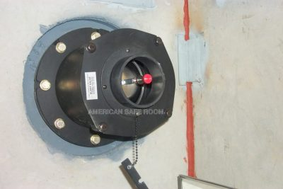 Blast valve mounted in a bomb shelter